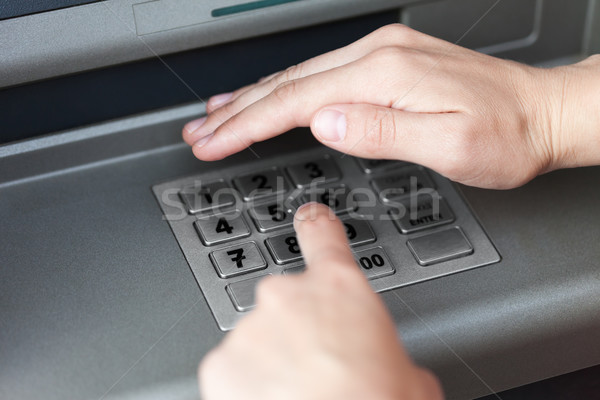 Stock photo: Entering atm cash machine pin code