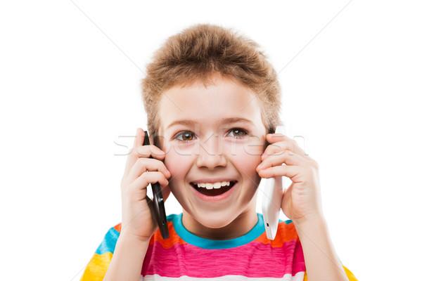 Mosolyog gyermek fiú beszél kettő mobiltelefonok Stock fotó © ia_64