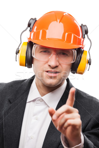 Businessman in safety hardhat helmet gesturing exclamation point Stock photo © ia_64