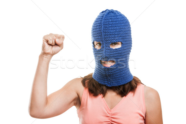 Woman in balaclava showing raised fist gesture Stock photo © ia_64