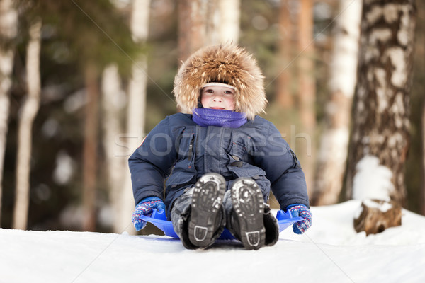Child sled on snow hill Stock photo © ia_64