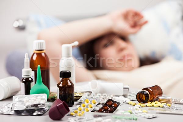 Indiszponált nő beteg fekszik ágy felnőtt Stock fotó © ia_64