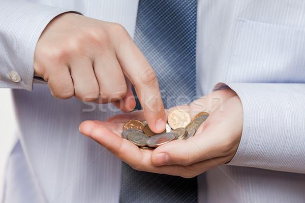 üzletember kéz tart érme megtakarított pénz pénz Stock fotó © ia_64