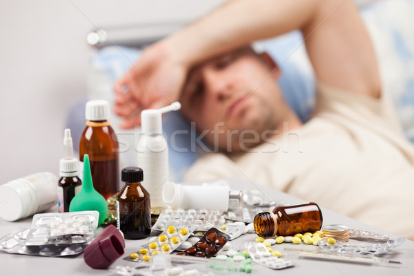 Unwell man patient lying down bed Stock photo © ia_64