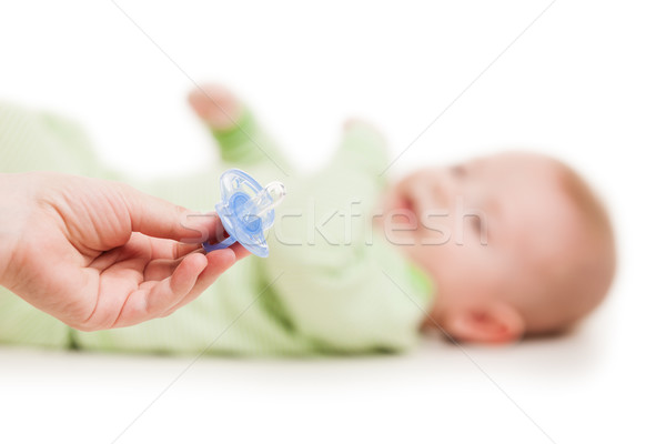 Mother giving soother pacifier to little sleeping newborn baby c Stock photo © ia_64