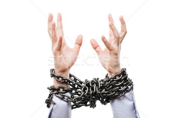 Businessman with metal chain tied hands raised for rescue help Stock photo © ia_64