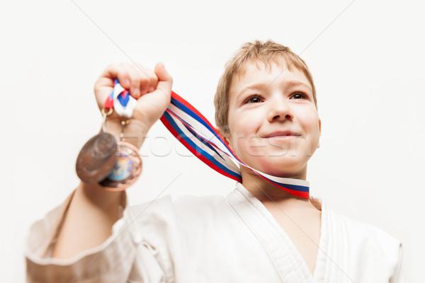 Mosolyog karate bajnok gyermek fiú gesztikulál Stock fotó © ia_64