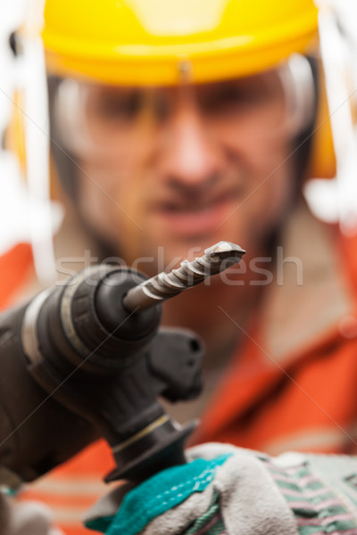 Engineer or manual worker man in safety hardhat helmet holding h Stock photo © ia_64