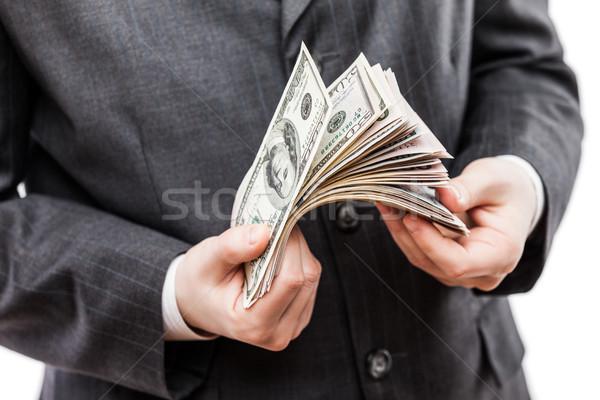 Işadamı siyah takım elbise el dolar para Stok fotoğraf © ia_64