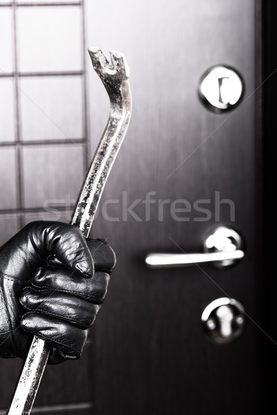 Burglar hand holding crowbar break opening door Stock photo © ia_64