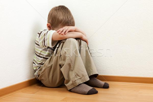 Gyermek büntetés kicsi fiú fal sarok Stock fotó © ia_64