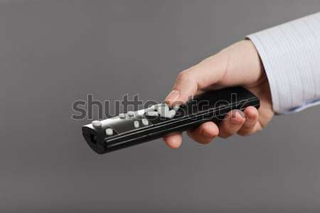 Human hand holding tv channel remote control Stock photo © ia_64