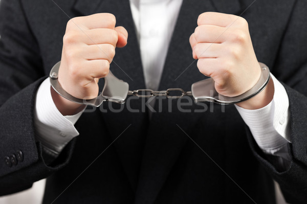 Stock photo: Handcuffs on hands