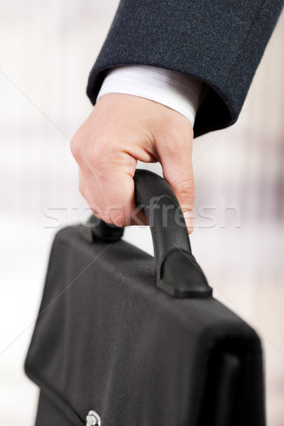Hand holding briefcase Stock photo © ia_64