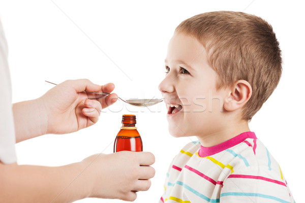 Doctor giving spoon of syrup to child boy Stock photo © ia_64