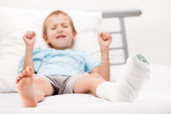 Little child boy with plaster bandage on leg heel fracture or br Stock photo © ia_64
