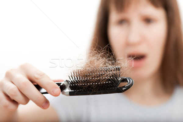 Loss hair comb in women hand Stock photo © ia_64