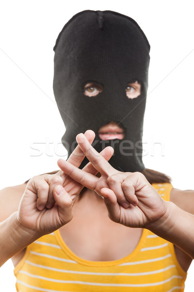 Woman in balaclava showing jail or prison finger gesture Stock photo © ia_64