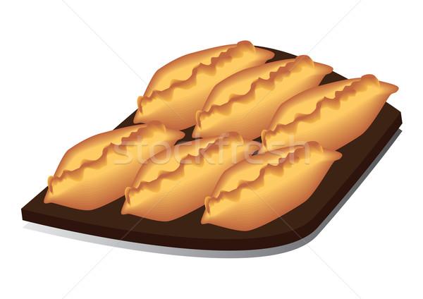 Bandeja empanadas frescos apetitoso alimentos Foto stock © iaRada