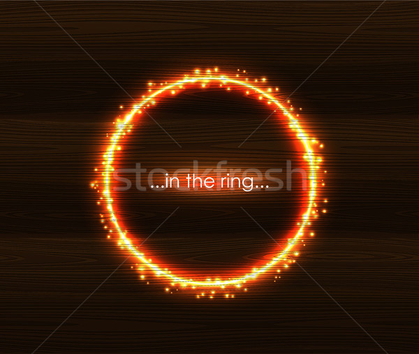 Fiery light round frame with spark. Flaming sparkling glow on wooden background. Burning ring orange Stock photo © Iaroslava