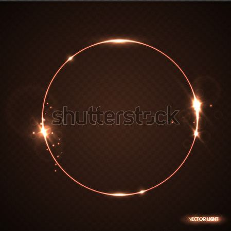 Vector golden frame with light effect flare and sparks. Shining round Christmas banner. Glow ring Stock photo © Iaroslava