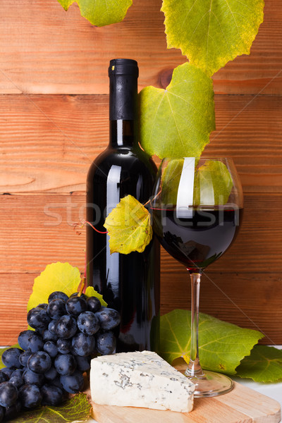 Red wine with cheese snack and blue grape Stock photo © icefront