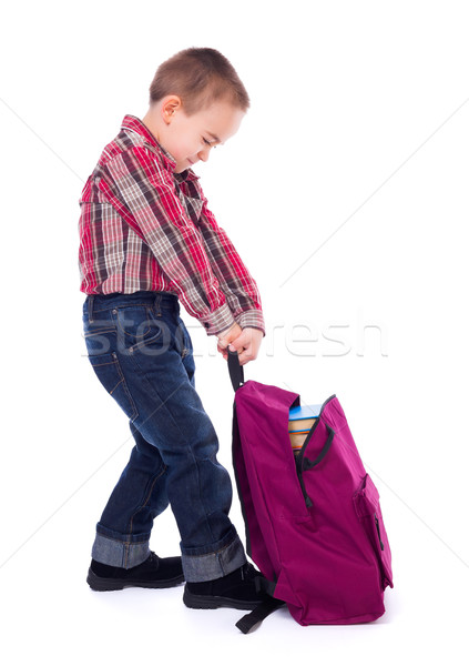 Little boy with heavy schoolbag Stock photo © icefront