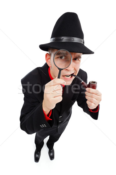 Curious detective looking through magnifier Stock photo © icefront