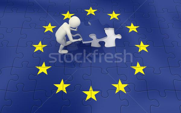 3d man finalizing European Union flag puzzle Stock photo © icefront