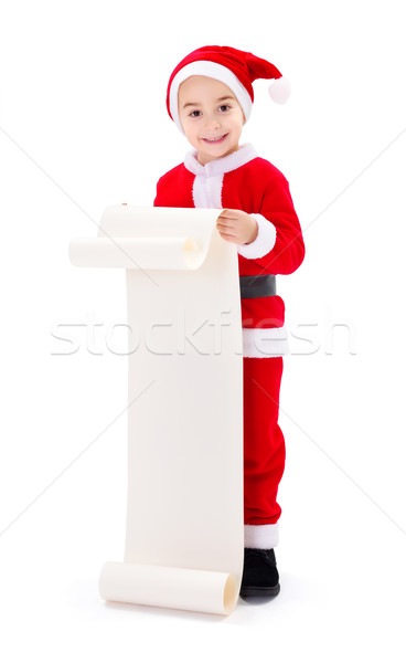 Little Santa Claus boy showing wish list Stock photo © icefront