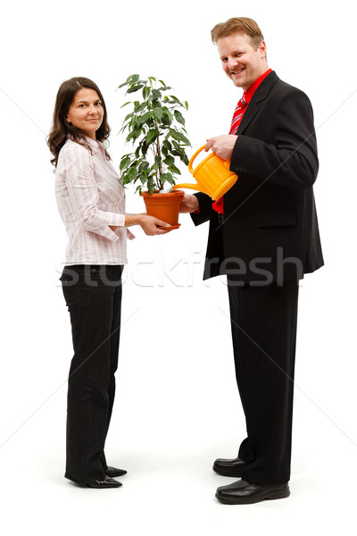 Happy couple watering plant Stock photo © icefront
