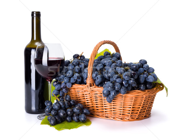 Red wine and ripe blue grape in basket Stock photo © icefront