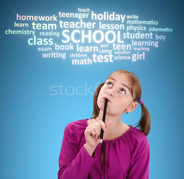 Iskolás lány gondolkodik iskola toll címke felhő Stock fotó © icefront