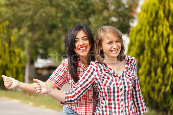 Hitch hiking girls Stock photo © icefront