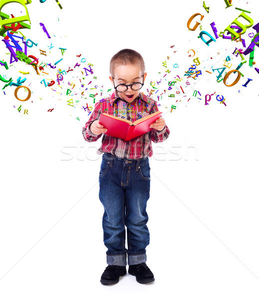 Little boy wondering of flying letters Stock photo © icefront