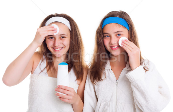 Girls cleaning theirs face with tonic lotion Stock photo © icefront
