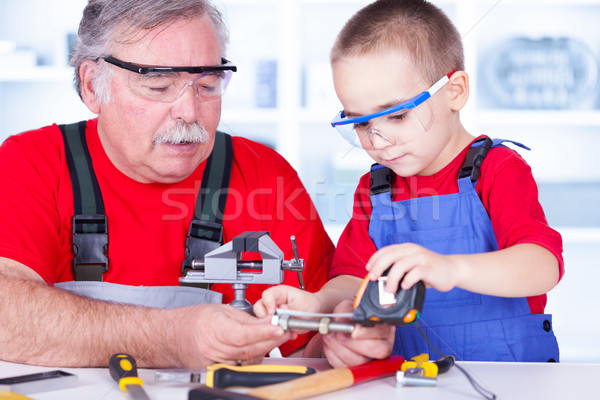 Grandfather and grandchild measuring bolt Stock photo © icefront
