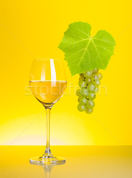Glass of white wine with grape cluster Stock photo © icefront