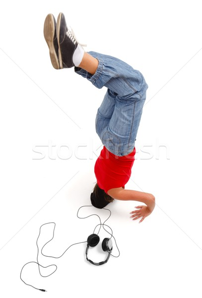 Happy young girl upside down Stock photo © icefront