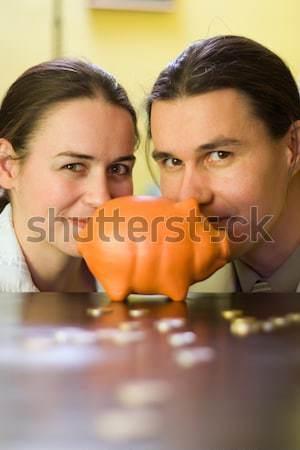Piggy Bank пару за монетами женщины Сток-фото © icefront