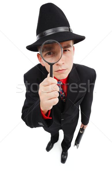 Sérieux détective regarder loupe jeunes serviette Photo stock © icefront