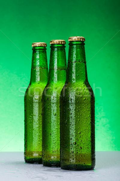 Trzy mokro piwa butelek szkła tle Zdjęcia stock © icefront