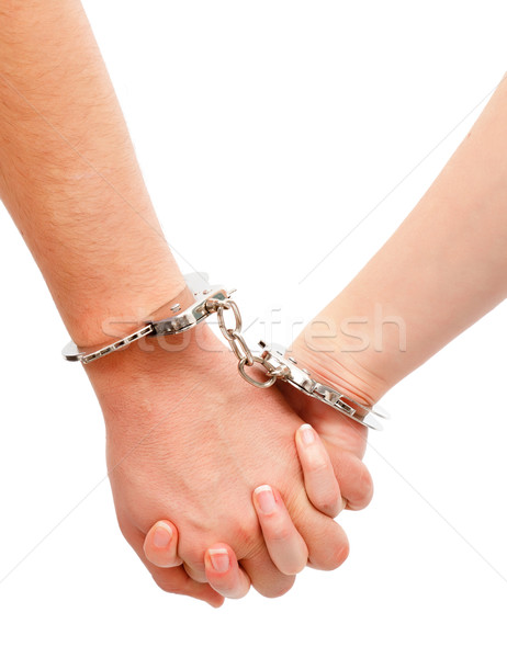 Couple's hands linked with handcuffs Stock photo © icefront