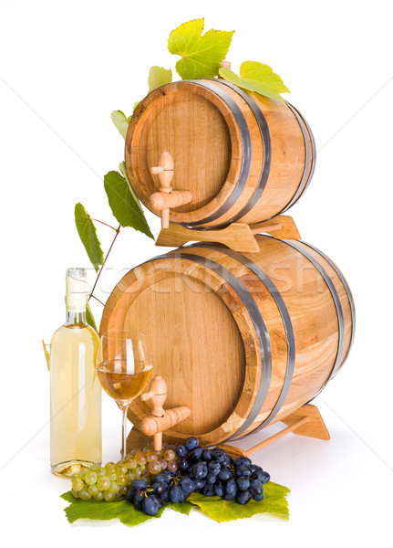 White wine in front of stacked barrels Stock photo © icefront