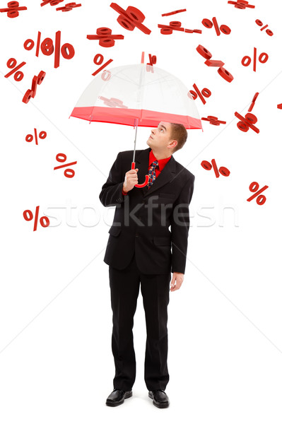 Man under falling percents Stock photo © icefront