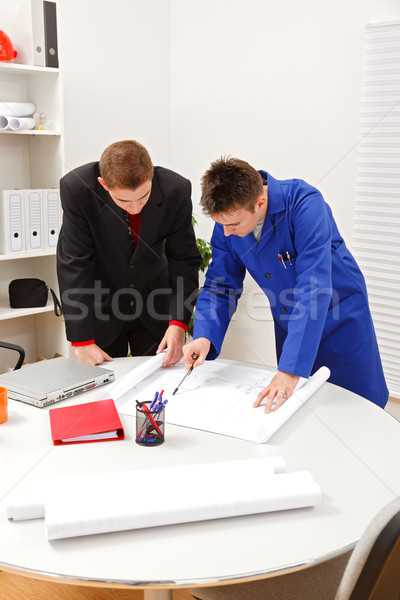 Boss and employee surveying plans Stock photo © icefront