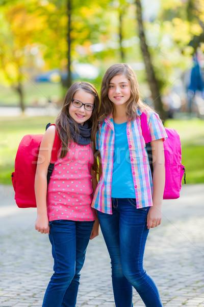 Teenage schoolgirls with schoolbag Stock photo © icefront