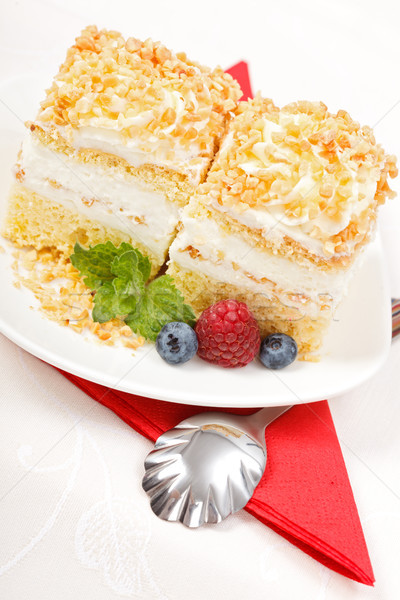 Top view of whipped cream cake garnished with berries Stock photo © icefront