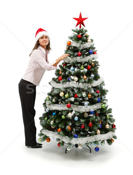 Woman decorating Christmas tree Stock photo © icefront