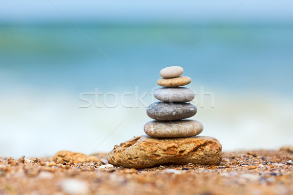 Stock photo: Stacked pebbles on the sea side